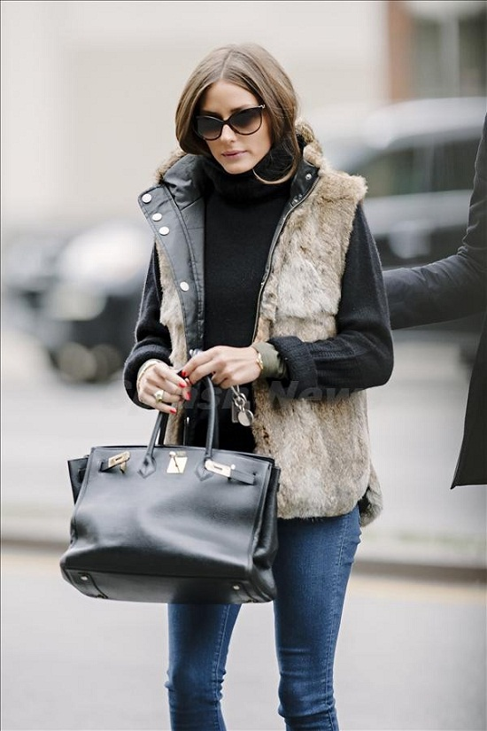 Olivia Palermo seen wearing fur vest while lunching with fiance Johannes Huebl in NYC