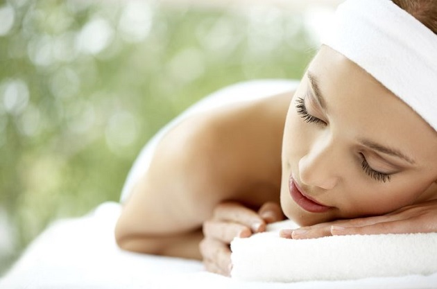 Young beautiful and relaxed lady taking spa treatment